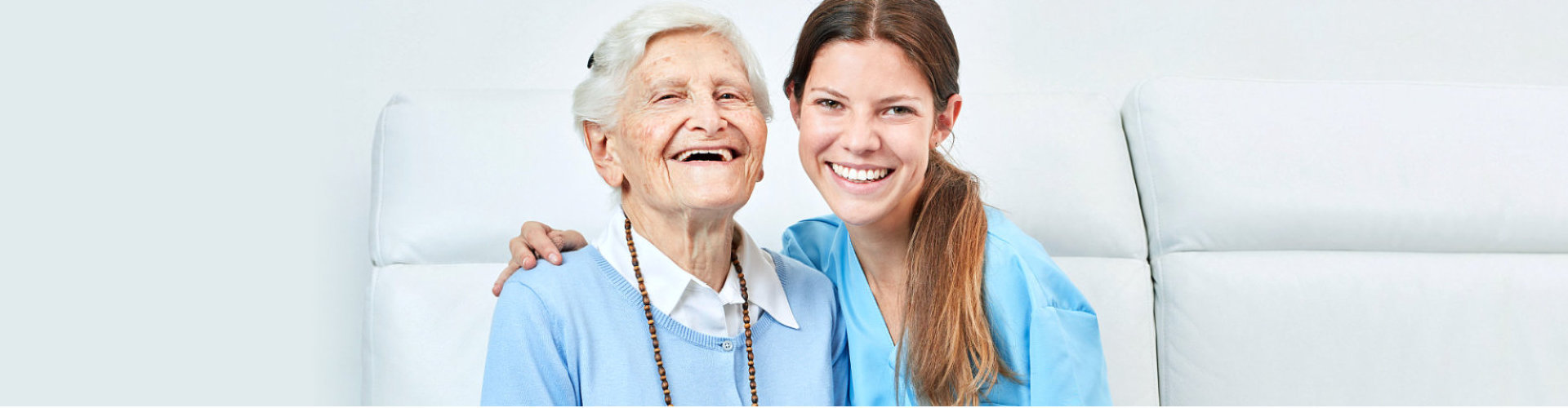 lady caregiver and old woman smiling